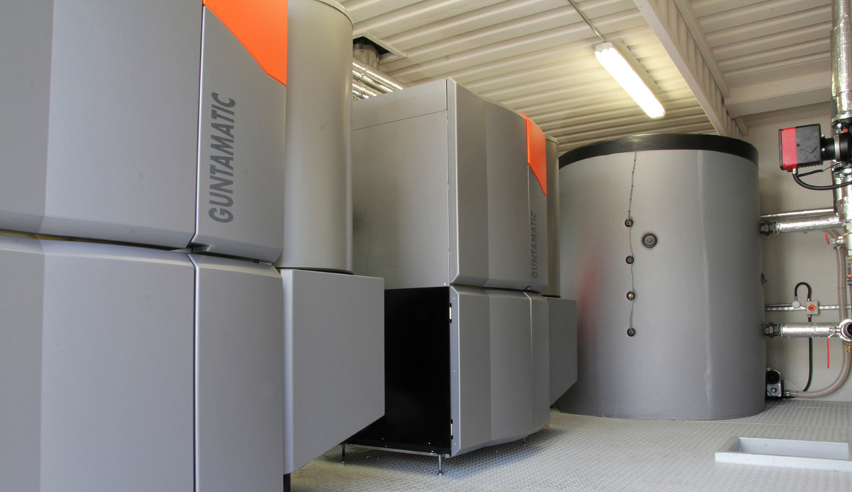 Guntamatic biomass boilers inside a containerised boiler plant room