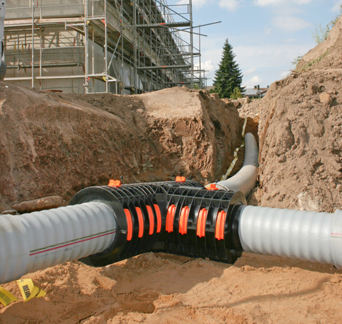 Rehau district heating underground heat main pipes on a building site