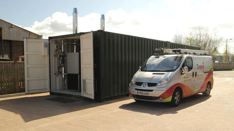 A containerised boiler plant room solution next to a Treco van